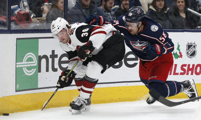 Arizona Coyotes' Christian Fischer, left, skates past Columbus Blue Jackets' David Savard during the first period of an NHL hockey game Tuesday, Dec. 3, 2019, in Columbus, Ohio. (AP Photo/Jay LaPrete)