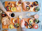 """<p>Why not celebrate the New Year with champagne's perfect pairing: brunch food? When the clock strikes midnight, pop bottles of bubbly alongside your <a href=""""https://www.goodhousekeeping.com/holidays/g1914/new-years-brunch/"""" rel=""""nofollow noopener"""" target=""""_blank"""" data-ylk=""""slk:favorite brunch dishes"""" class=""""link rapid-noclick-resp"""">favorite brunch dishes</a>, so you can ring in 2021 with a plate full of bacon and avocado toast. You'll be up until dawn anyway, so why not have an early brunch while you're at it?</p>"""