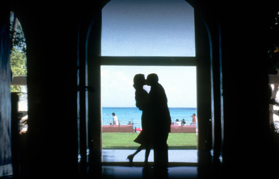 Emily Watson kisses Adam Sandler in a scene from the film 'Punch-Drunk Love', 2002. (Photo by Columbia Pictures/Getty Images)