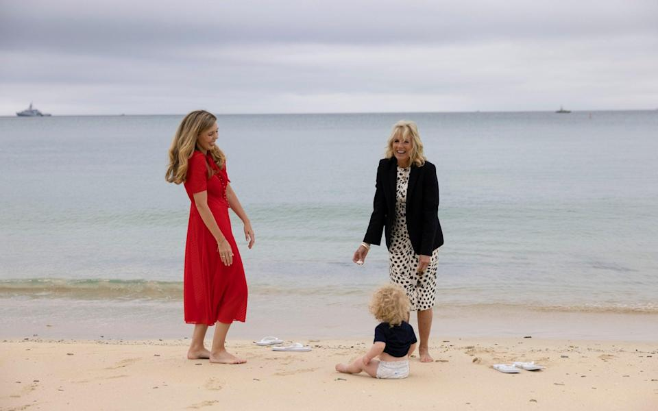 Dr Jill Biden smiles with Carrie Johnson and her son Wilfred on the beach during the G7 leaders Summit in Carbis Bay Cornwall - No10 Downing Street