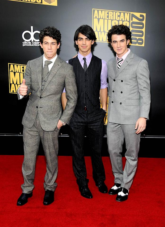 "The Jonas Brothers (Nick, Joe, and Kevin) were a dapper trio as they arrived at the 2008 American Music Awards held at the Nokia Theatre in Los Angeles. We're glad they weren't wearing their skinny jeans when they accepted the award for Breakthrough Artist! Kevin Mazur/<a href=""http://www.wireimage.com"" target=""new"">WireImage.com</a> - November 23, 2008"