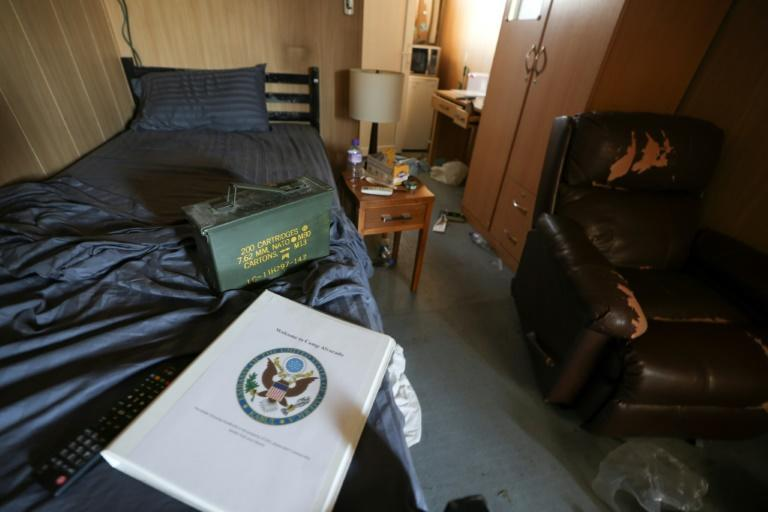 A folder with a US army insignia is seen next to an ammunition box in a room inside a room at Kabul airport (AFP/Karim SAHIB)