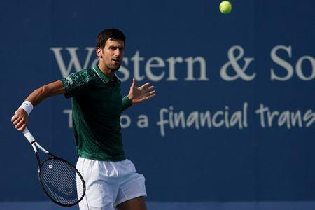 Aug 17, 2018; Mason, OH, USA; Novak Djokovic (SRB) returns a shot against Milos Raonic (CAN) in the Western and Southern tennis open at Lindner Family Tennis Center. Mandatory Credit: Aaron Doster-USA TODAY Sports