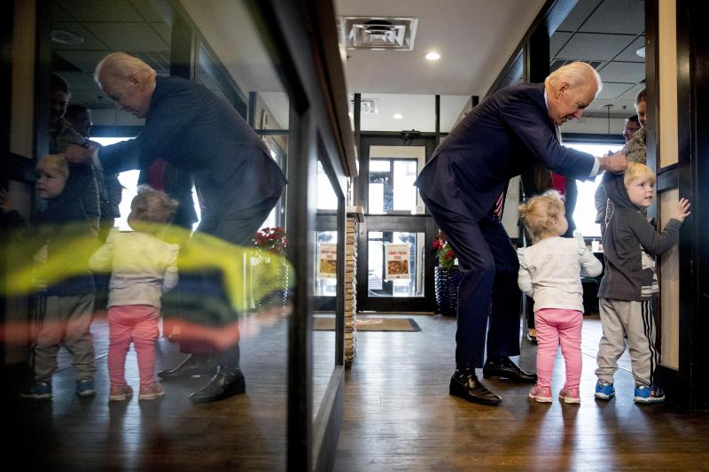 FILE - In this Jan. 6, 2020, file photo Democratic presidential candidate former Vice President Joe Biden speaks with Jack Maiers, 4, and his sister Olive, 2, of Bettendorf, Iowa, as he arrives for lunch at Ross' Restaurant in Bettendorf, Iowa. Biden has won the last few delegates he needed to clinch the Democratic nomination for president. (AP Photo/Andrew Harnik, File)
