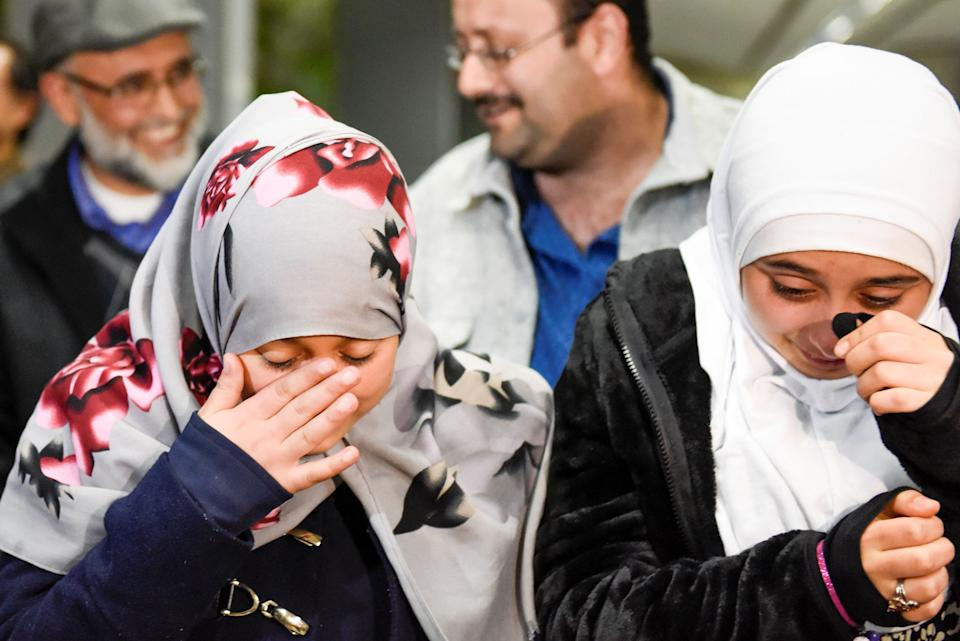 Eman Ali of Yemen, 12, cries with her sister Salma Ali after they meetfor the first time in years at San Francisco International Airport in San Francisco, California, Feb. 5, 2017. The 12-year-old and her father were blocked entry into the United States because of the order.