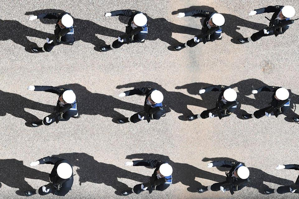 <p>Sailors in the Royal Navy participate in the military march. Prince Philip served in the British Royal Navy and fought in World War II. </p>