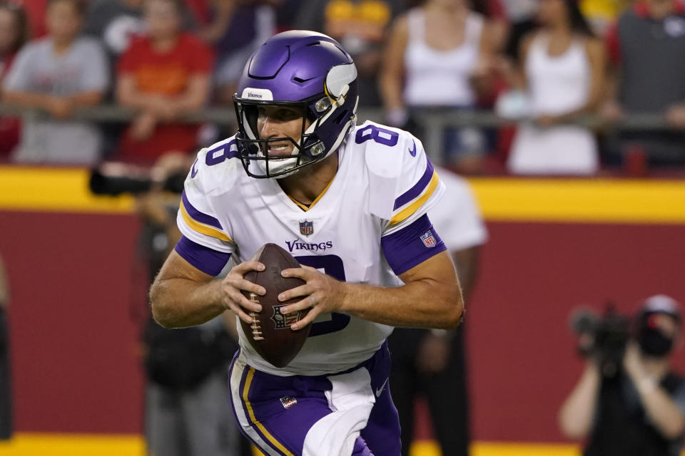 Minnesota Vikings quarterback Kirk Cousins drops back to pass during the first half of an NFL football game against the Kansas City Chiefs Friday, Aug. 27, 2021, in Kansas City, Mo. (AP Photo/Ed Zurga)