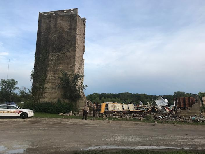 Between 50 and 100 onlookers stopped by the Hill-Top Drive-In to survey the damage. Image via John Ferak, Joliet Patch Editor