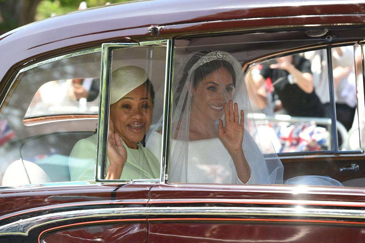 Meghan Markle (R) and her mother, Doria Ragland, arrive for her wedding ceremony to marry Britain's Prince Harry, Duke of Sussex, at St George's Chapel, Windsor Castle, in Windsor, on May 19, 2018. (Photo by Oli SCARFF / AFP)        (Photo credit should read OLI SCARFF/AFP/Getty Images)