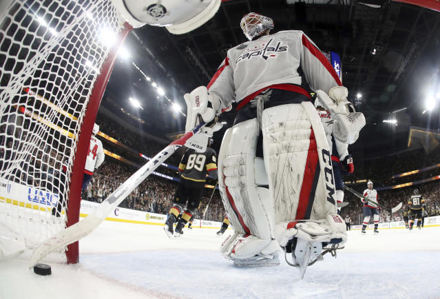 Washington Capitals goaltender Braden Holtby removes the puck from inside the goal after Vegas Golden Knights defenseman Shea Theodore scored during the second period in Game 2 of the NHL hockey Stanley Cup Finals on Wednesday, May 30, 2018, in Las Vegas. (Bruce Bennett/Pool via AP)