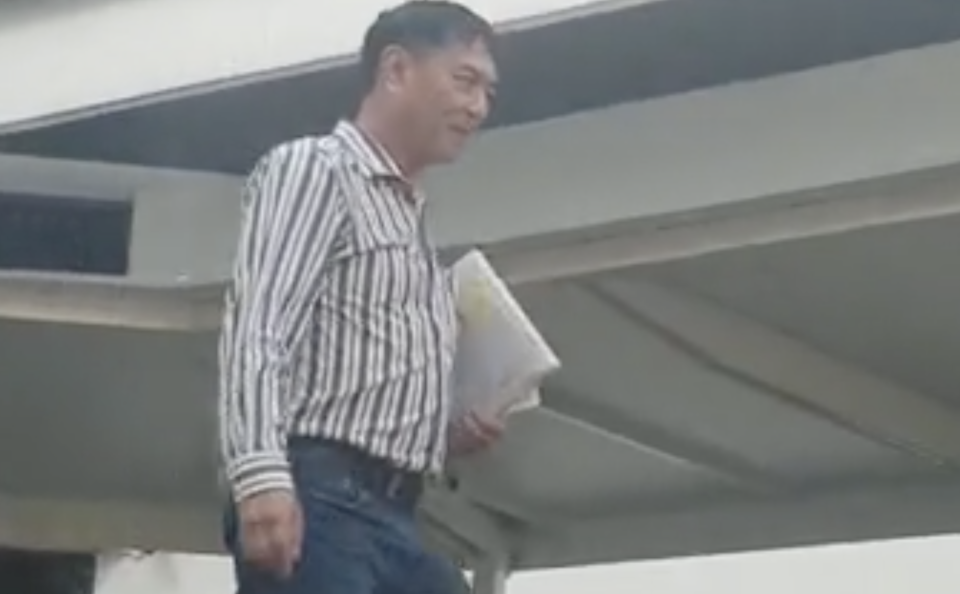Huang Yi Liang leaving the State Courts on 29 November 2019 after he was charged for assault. (PHOTO: Yahoo News Singapore/Wan Ting Koh)