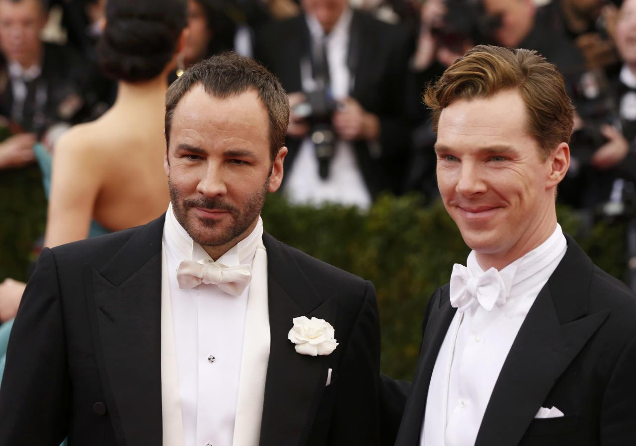 "Designer Tom Ford (L) and actor Benedict Cumberbatch arrive at the Metropolitan Museum of Art Costume Institute Gala Benefit celebrating the opening of ""Charles James: Beyond Fashion"" in Upper Manhattan, New York, May 5, 2014. REUTERS/Lucas Jackson (UNITED STATES - Tags: ENTERTAINMENT FASHION)"
