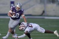Kansas State fullback Jax Dineen (29) gets past Oklahoma State cornerback Thomas Harper (13) during the first half of an NCAA college football game in Manhattan, Kan., Saturday, Nov. 7, 2020. (AP Photo/Orlin Wagner)