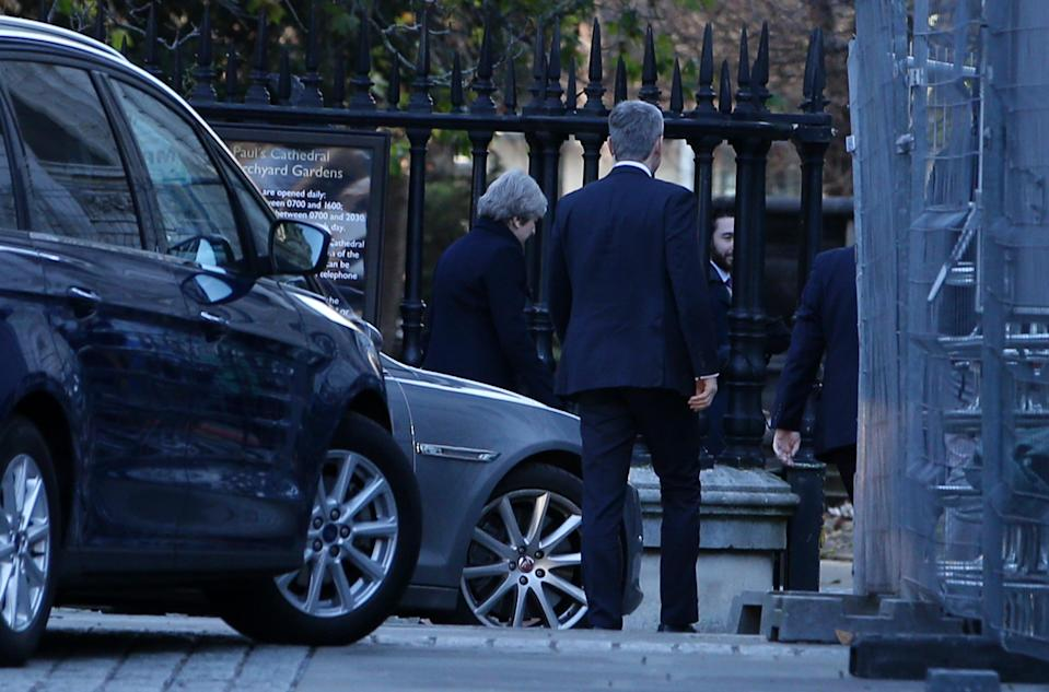 Theresa May enters at the back of St Pauls Cathedral (Picture: REX)