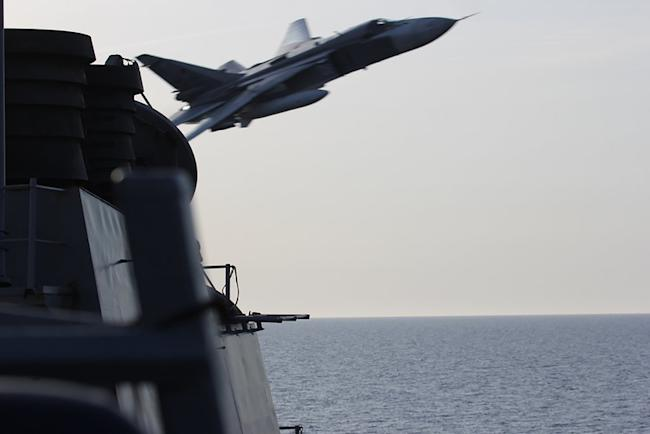 REFILE - ADDING DATEAn U.S. Navy picture shows what appears to be a Russian Sukhoi SU-24 attack aircraft making a very low pass close to the U.S. guided missile destroyer USS Donald Cook in the Baltic Sea in this picture taken April 12, 2016 and released April 13, 2016. REUTERS/US Navy/Handout via Reuters