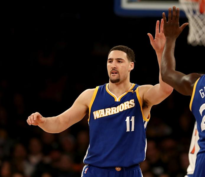 Klay Thompson of the Golden State Warriors celebrates after scoring a point
