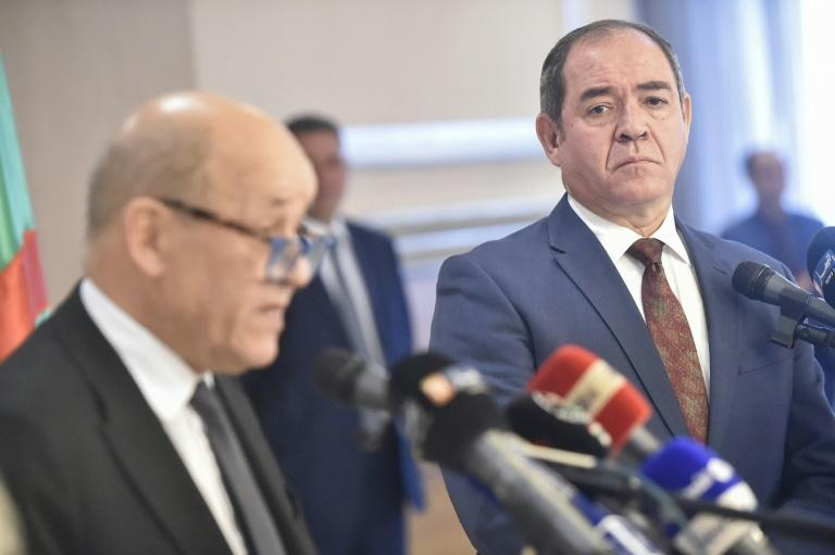 Algerian Foreign Minister Sabri Boukadoum (R) listens to his French counterpart Jean-Yves Le Drian during a joint press conference in the capital Algiers