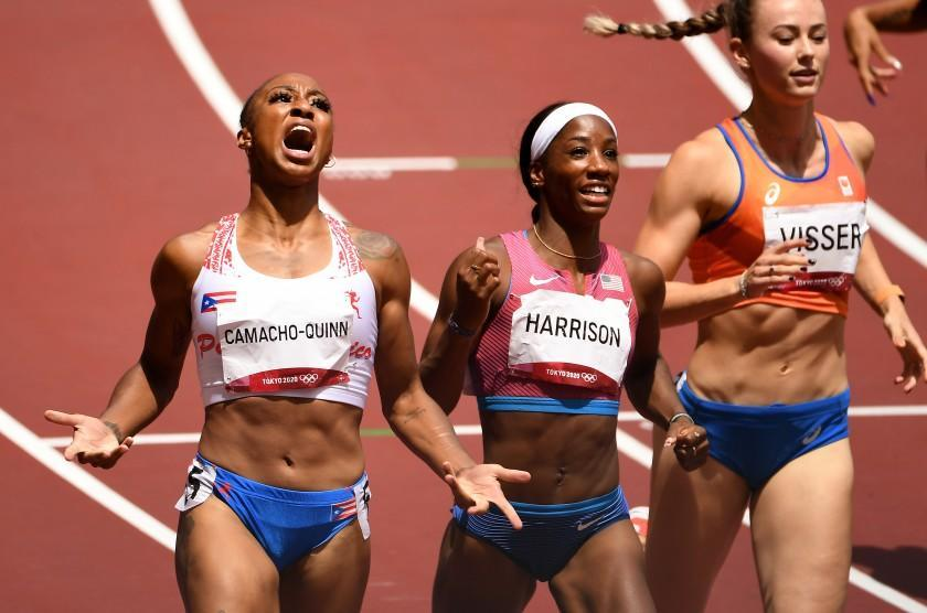 -TOKYO,JAPAN August 2, 2021: Puerto Rico's Jasmine Camacho-Quinn, left, reacts after defeating USA's Kendra Harrison in the 100m hurdles at the 2020 Tokyo Olympics. (Wally Skalij /Los Angeles Times)