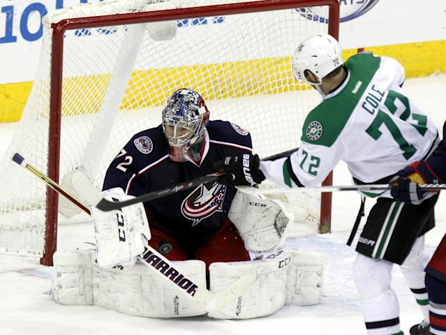 Columbus Blue Jackets goalie Sergi Bobrovsky, left, of Russia, stops a shot by Dallas Stars' Erik Cole in the third period of an NHL hockey game in Columbus, Ohio, Tuesday, March 4, 2014. Columbus won 4-2. (AP Photo/Paul Vernon)