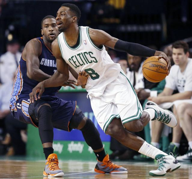 Boston Celtics' Jeff Green (8) drives past Charlotte Bobcats' Michael Kidd-Gilchrist (14) in the second quarter of an NBA basketball game in Boston, Friday, April 11, 2014. (AP Photo/Michael Dwyer)