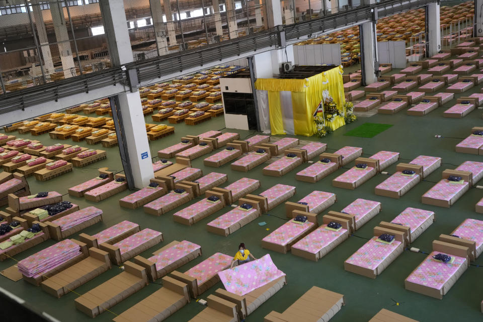 A 1,800-bed field hospital is set up inside a cargo building in Don Mueang International Airport in Bangkok, Thailand, Thursday, July 29, 2021. Health authorities raced on Thursday to set up yet another large field hospital in Thailand's capital as the country recorded a new high in COVID-19 cases and deaths. The hospital, one of many already in use, was being set up at one of Bangkok's two international airports after the capital ran out of hospital beds for thousands of infected residents. (AP Photo/Sakchai Lalit)
