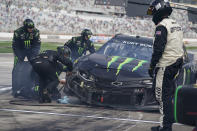 NASCAR Cup Series driver Kurt Busch's team works on his car after a wreck preventing him from continuing during a NASCAR Cup Series at Atlanta Motor Speedway on Sunday, March 21, 2021, in Hampton, Ga. (AP Photo/Brynn Anderson)