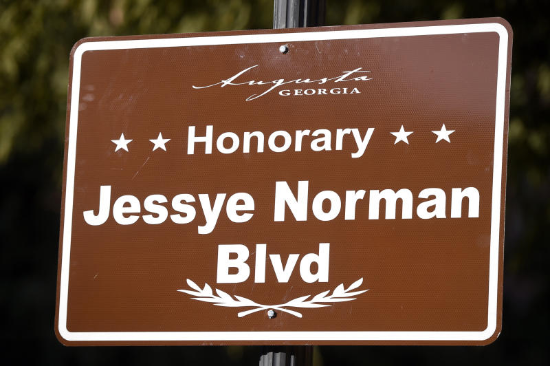 In this Friday, Oct. 11, 2019 photo, a new street sign was unveiled during the Jessye Norman Boulevard honorary street naming ceremony in Augusta, Ga. The city renamed a street for Norman outside the Jessye Norman School of the Arts, which she opened in 2003 to provide free fine arts education to disadvantaged children. (Michael Holahan/The Augusta Chronicle via AP)