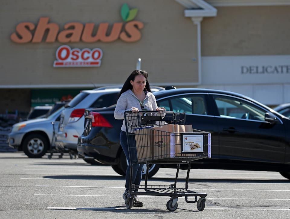 FALMOUTH, MA - APRIL 8: Instacart shopper Loralyn Geggatt finishes shopping at Shaws for a customer during the COVID-19 pandemic in Falmouth, MA on April 7, 2020. Some Amazon, Instacart and other workers protested for better wages, hazard pay and sick time. (Photo by David L. Ryan/The Boston Globe via Getty Images)