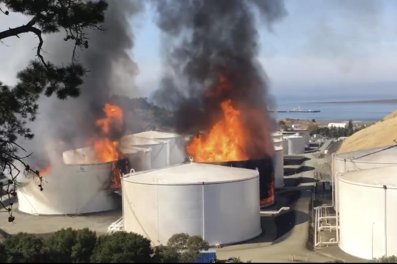 ADDS NAME AND LOCATION OF OIL STORAGE FACILITY In this image from video provided by the Napa County Sheriff's Office, tanks are on fire at an oil storage facility Tuesday, Oct. 15, 2019, viewed from Rodeo, Calif. A fire burning at NuStar Energy LP facility in Crockett, Calif, in the San Francisco Bay Area prompted a hazardous materials emergency that led authorities to order the residents of two communities, Crockett and Rodeo, Calif., to shelter in place and stay inside with all windows and doors closed. Contra Costa Fire Department spokesman Steve Hill said that an hour into battling the blaze, firefighters seemed to be making progress and were continuing to keep adjacent tanks cooled with water. (Henry Wofford/Napa County Sheriff's Office via AP)