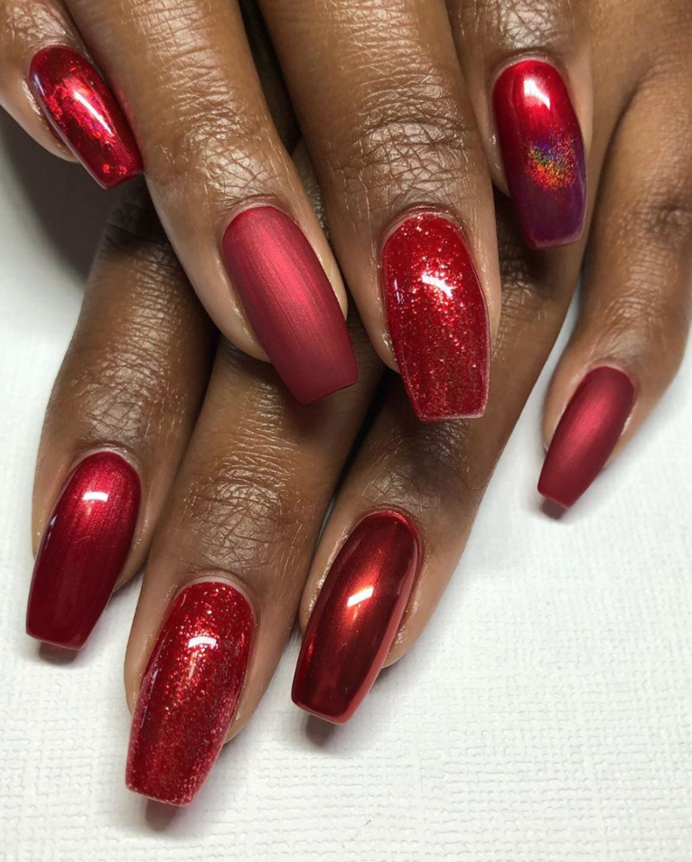 "<p><a href=""https://www.instagram.com/thenaillionaire/"" rel=""nofollow noopener"" target=""_blank"" data-ylk=""slk:Nail artist Jessica Reohr"" class=""link rapid-noclick-resp"">Nail artist Jessica Reohr</a> jazzes up an all-red manicure with pops of glitter for the holidays.</p><p><a class=""link rapid-noclick-resp"" href=""https://go.redirectingat.com?id=74968X1596630&url=https%3A%2F%2Fwww.ulta.com%2Fsesame-street-50th-anniversary-holiday-collection%3FproductId%3Dpimprod2008735%26sku%3D2555097&sref=https%3A%2F%2Fwww.oprahmag.com%2Fbeauty%2Fg34113691%2Fchristmas-nail-ideas%2F"" rel=""nofollow noopener"" target=""_blank"" data-ylk=""slk:SHOP GLITTER POLISH"">SHOP GLITTER POLISH</a></p>"