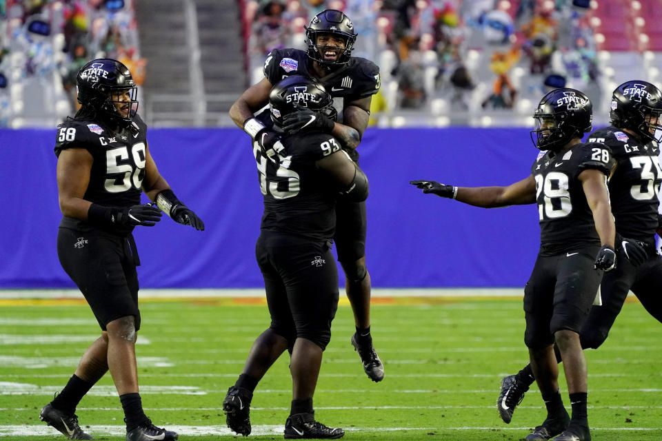 Iowa State linebacker O'Rien Vance celebrates a defensive stop with defensive tackle Isaiah Lee (93), Breece Hall (28) and defensive end Eyioma Uwazurike (58) during the second half of the Fiesta Bowl NCAA college football game against Oregon, Saturday, Jan. 2, 2021, in Glendale, Ariz. (AP Photo/Rick Scuteri)