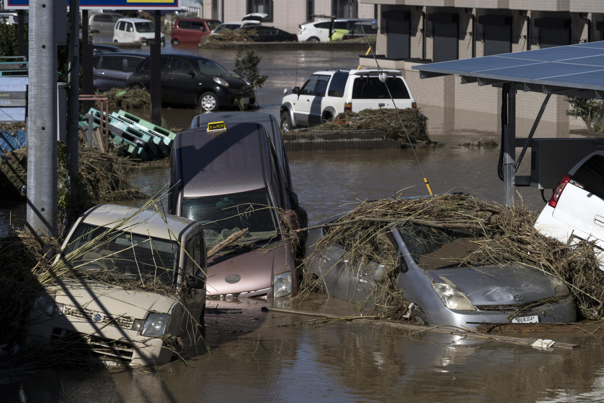 Vehicles sit partially submerged in floodwaters following Typhoon Hagibis on Oct. 13, 2019, in Sano, Japan. (Photo: Tomohiro Ohsumi/Getty Images)
