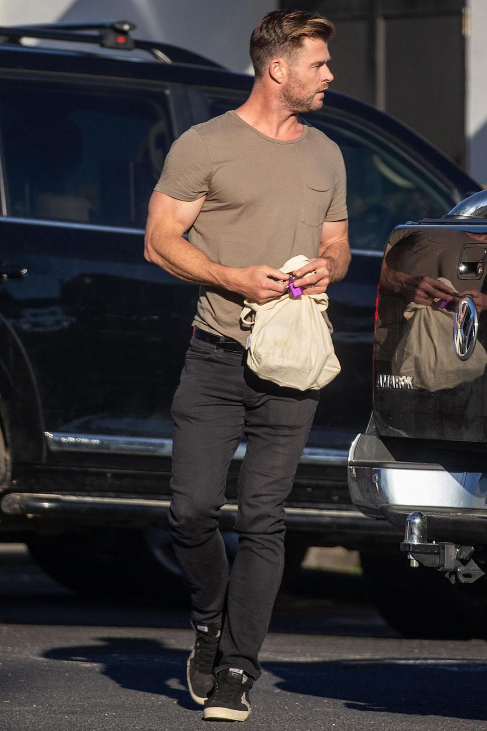 <p>Chris Hemsworth heads to a grocery store in Byron Bay, Australia, on Sunday.</p>