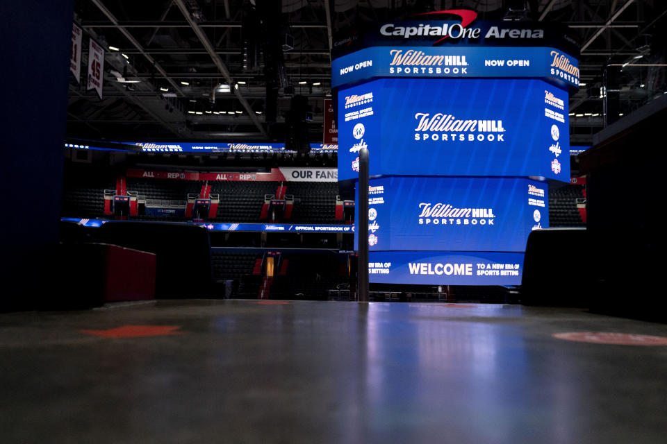 Screens display the William Hill Sportsbook logo at Monumental Sports & Entertainment's Capital One Arena in Washington, Wednesday, May 26, 2021. The first full-service sportsbook at a major four North American pro sports venue in the United States opens its doors. (AP Photo/Andrew Harnik)