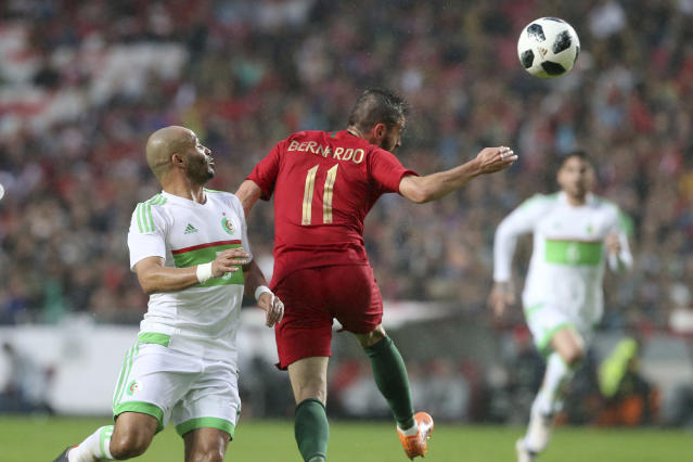 Portugal's Bernardo Silva, shots on goal to score his side's first goal during a friendly soccer match between Portugal and Algeria in Lisbon, Portugal, Thursday, June 7, 2018. (AP Photo/Armando Franca)