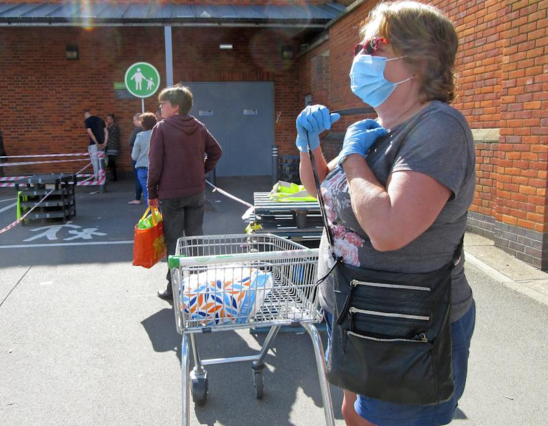 A woman wearing a face mask and gloves as a precaution while in a queues to enter a supermarket amid Coronavirus pandemic. Shoppers Queue and observe necessary Social distancing which has become the new rule in the UK. (Photo by Keith Mayhew / SOPA Images/Sipa USA)