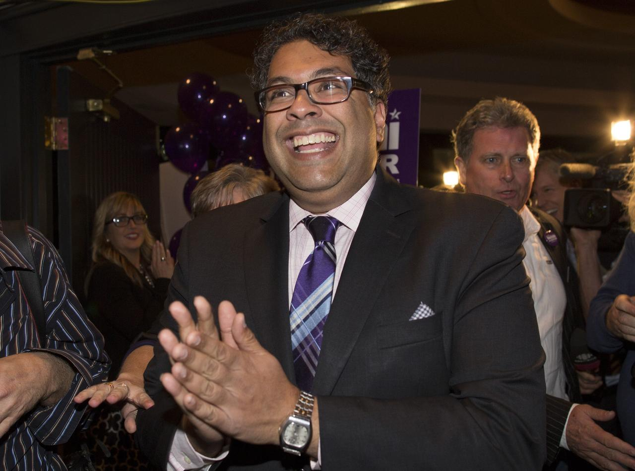 Naheed Nenshi reacts after he was elected Calgary mayor for a second term in Calgary, Alberta, October 21, 2013. In 2010, Nenshi was elected the first Muslim mayor of a major North American city. REUTERS/Todd Korol (CANADA - Tags: POLITICS ELECTIONS)