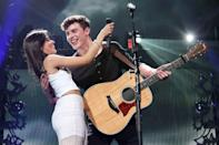 "The rumored couple started heating up after they dropped their <a href=""https://people.com/music/camila-cabello-shawn-mendes-senorita-music-video/"" rel=""nofollow noopener"" target=""_blank"" data-ylk=""slk:steamy music video"" class=""link rapid-noclick-resp"">steamy music video</a> for their duet, ""Señorita."" The video, which was released days before Cabello's <a href=""https://people.com/music/camila-cabello-splits-from-relationship-coach-matthew-hussey-after-more-than-1-year-together/"" rel=""nofollow noopener"" target=""_blank"" data-ylk=""slk:split from Matthew Hussey"" class=""link rapid-noclick-resp"">split from Matthew Hussey</a> was confirmed, has Mendes and Cabello playing lovers who can't seem to quit each other. The fictional storyline may not be so far from the truth because just a few weeks after the video dropped, the two were spotted <a href=""https://twitter.com/ShawnMendessArg/status/1146909950683357184"" rel=""nofollow noopener"" target=""_blank"" data-ylk=""slk:cozying up by an infinity pool"" class=""link rapid-noclick-resp"">cozying up by an infinity pool</a> as they <a href=""https://people.com/celebrity/july-fourth-2019-celebrity-celebrations/"" rel=""nofollow noopener"" target=""_blank"" data-ylk=""slk:celebrated the Fourth of July"" class=""link rapid-noclick-resp"">celebrated the Fourth of July</a> together, <a href=""https://people.com/music/shawn-mendes-camila-cabello-holding-hands-fourth-of-july/"" rel=""nofollow noopener"" target=""_blank"" data-ylk=""slk:holding hands"" class=""link rapid-noclick-resp"">holding hands</a> later that night out in West Hollywood, California, and <a href=""https://people.com/music/shawn-mendes-camila-cabello-spotted-pda-romance-rumors/"" rel=""nofollow noopener"" target=""_blank"" data-ylk=""slk:holding hands again"" class=""link rapid-noclick-resp"">holding hands again</a> three days later after grabbing brunch in L.A. By September, the couple stopped being shy about their relationship status and decided to <a href=""https://people.com/music/shawn-mendes-camila-cabello-kissing-video/"" rel=""nofollow noopener"" target=""_blank"" data-ylk=""slk:publicly address criticism"" class=""link rapid-noclick-resp"">publicly address criticism</a> they recieved on Twitter about their PDA. ""So we saw on Twitter and stuff you guys saying stuff about the way were kissing and how it looks weird like we kiss like fish,"" Mendes explained in <a href=""https://www.instagram.com/p/B2TF8KbgR5o/?utm_source=ig_embed"" rel=""nofollow noopener"" target=""_blank"" data-ylk=""slk:an Instagram video"" class=""link rapid-noclick-resp"">an Instagram video</a> posted on Sept. 11. ""Yeah, it really hurt our feelings,"" Cabello chimed in. ""We just want to show you how we really kiss,"" Mendes said as the couple leaned in for a seemingly romantic kiss, but things quickly took a comedic turn as Cabello stuck her tongue in Mendes' mouth and the two jokingly had an over-the-top makeout session. As they pulled away, the pair laughed before turning off the video."