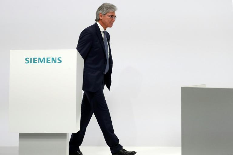 Former Siemens chief executive Joe Kaeser handed over to his deputy Roland Busch