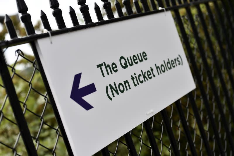 FILE PHOTO: A sign is seen for the ticket queue at Wimbledon in London