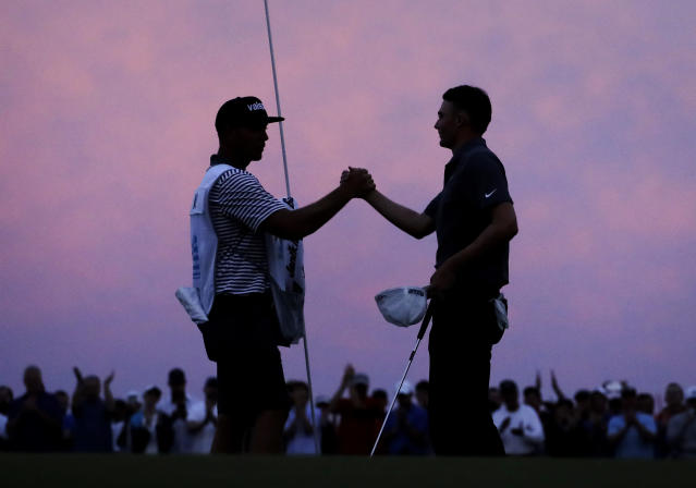 Caddie Brian Dilley, left, congratulates Aaron Wise after Wise won the AT&T Byron Nelson golf tournament in Dallas, Sunday, May 20, 2018. (AP Photo/Eric Gay)