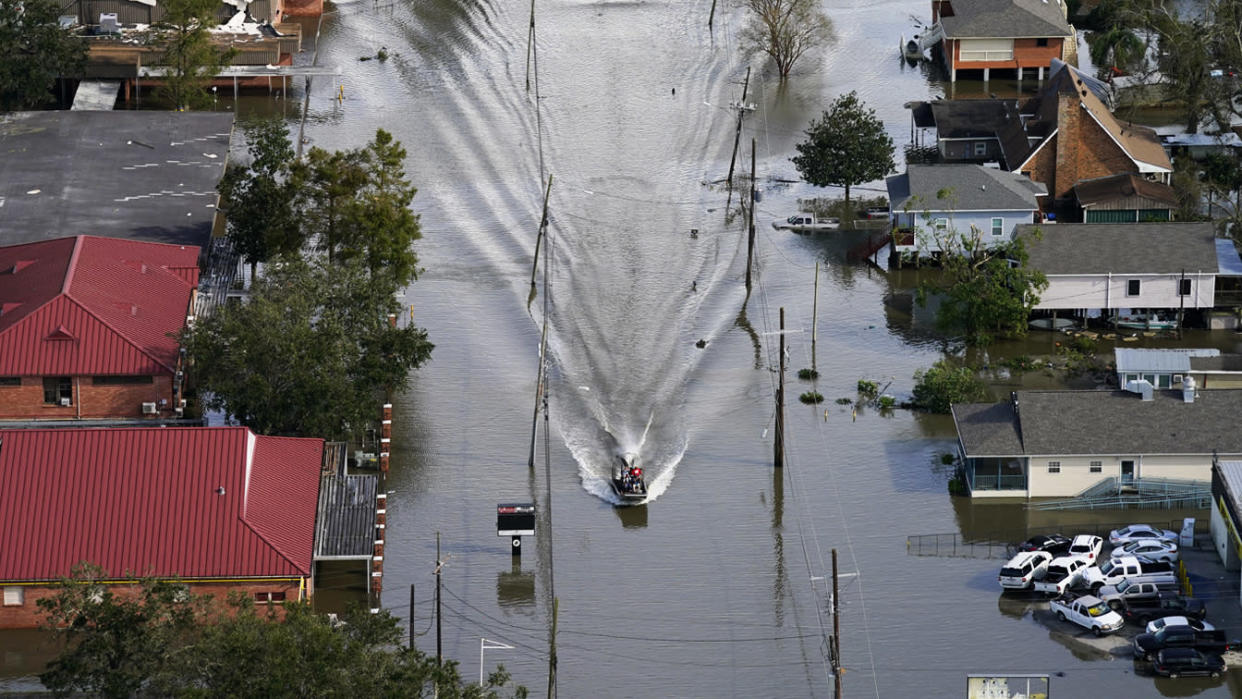 An Airboat glides over a city street in the aftermath of Hurricane Ida, Monday, Aug. 30, 2021, in Lafitte, La. (David J. Phillip/AP Photo)