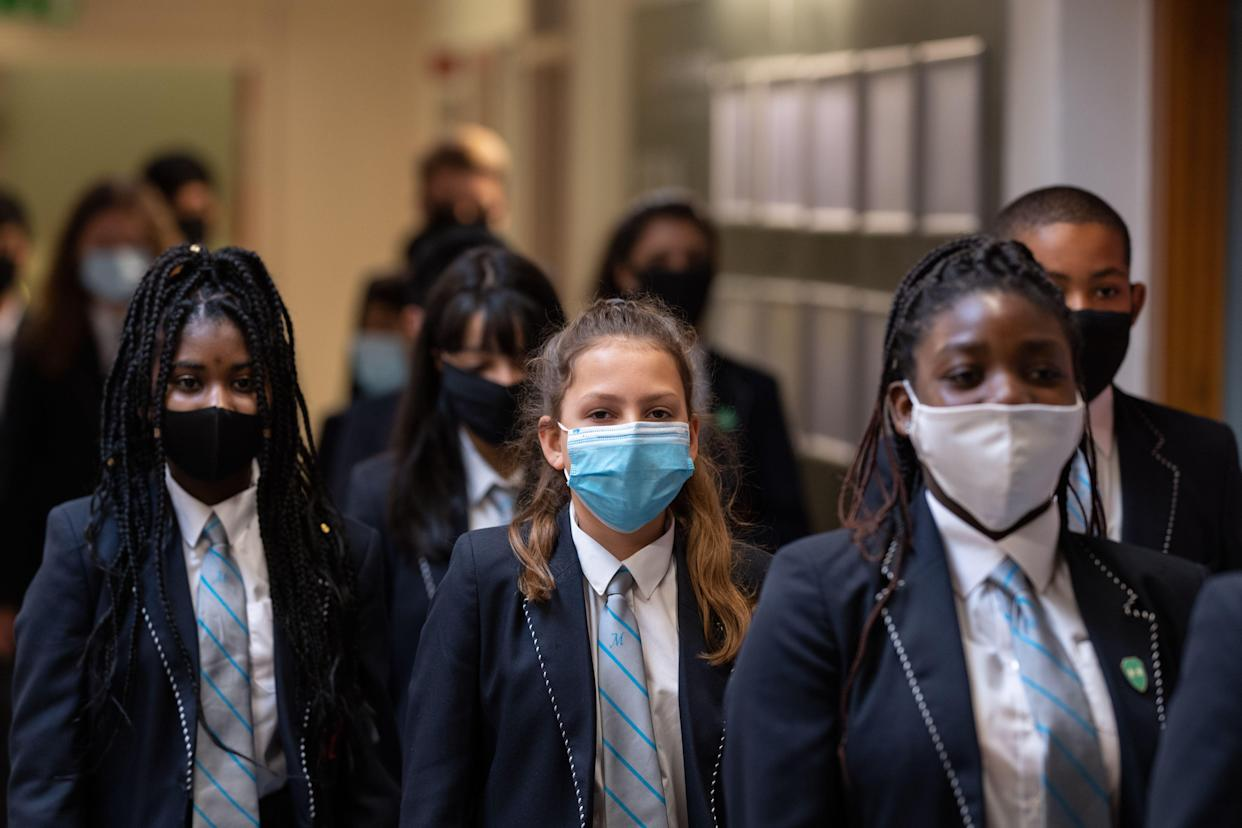 Year eight pupils wear face masks as a precaution against the transmission of the novel coronavirus. (Getty)