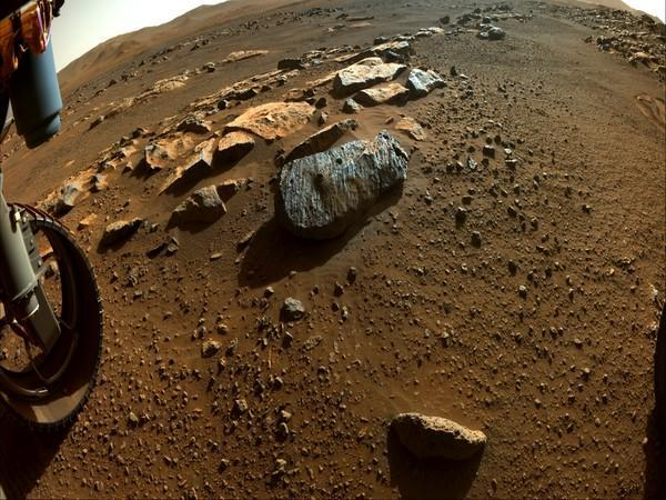 Visual of NASA's Perseverance Rover while collecting puzzle pieces of Mars' history