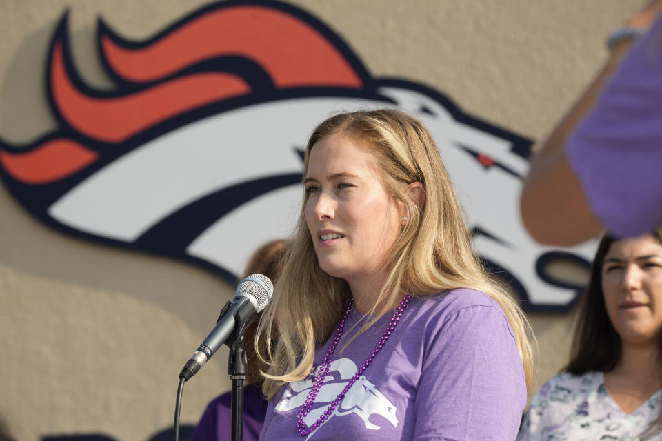 Brittany Bowlen speaks during a news conference to raise awareness of Alzheimer's disease outside the Denver Broncos' headquarters Wednesday, Aug. 18, 2021, in Englewood, Colo. Both Pat Bowlen, the deceased owner of the Broncos, and now his wife, Annabelle, have dealt with the disease. (AP Photo/David Zalubowski)