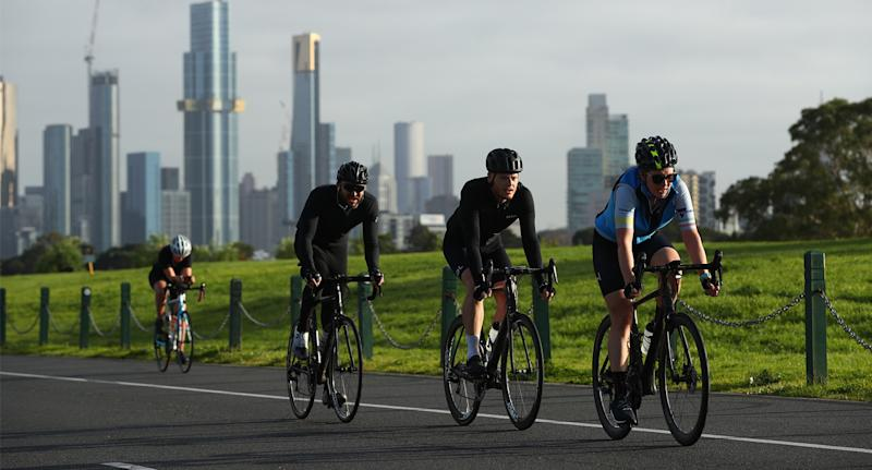Photo shows cyclists in Melbourne riding on the road.