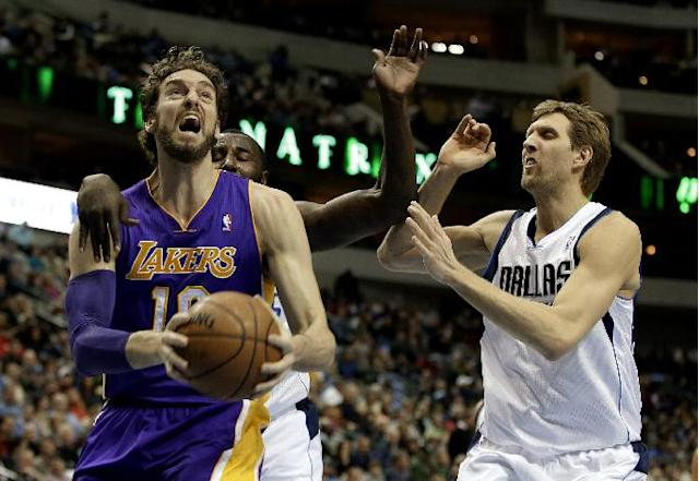 Los Angeles Lakers' Pau Gasol (16) of Spain gets by Dallas Mavericks' DeJuan Blair, left rear, and Dirk Nowitzki, right, on a drive to the basket in the first half of an NBA basketball game, Tuesday, Jan. 7, 2014, in Dallas