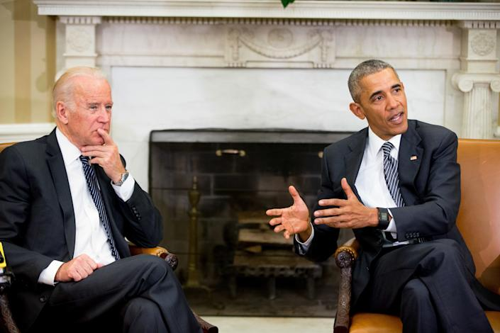 President Barack Obama, accompanied by Vice President Joe Biden, left, speaks to members of the media after receiving a briefing on the ongoing response to the Zika virus from members of his public health team in the Oval Office at the White House in Washington, Friday, May 20, 2016. (Andrew Harnik/AP)