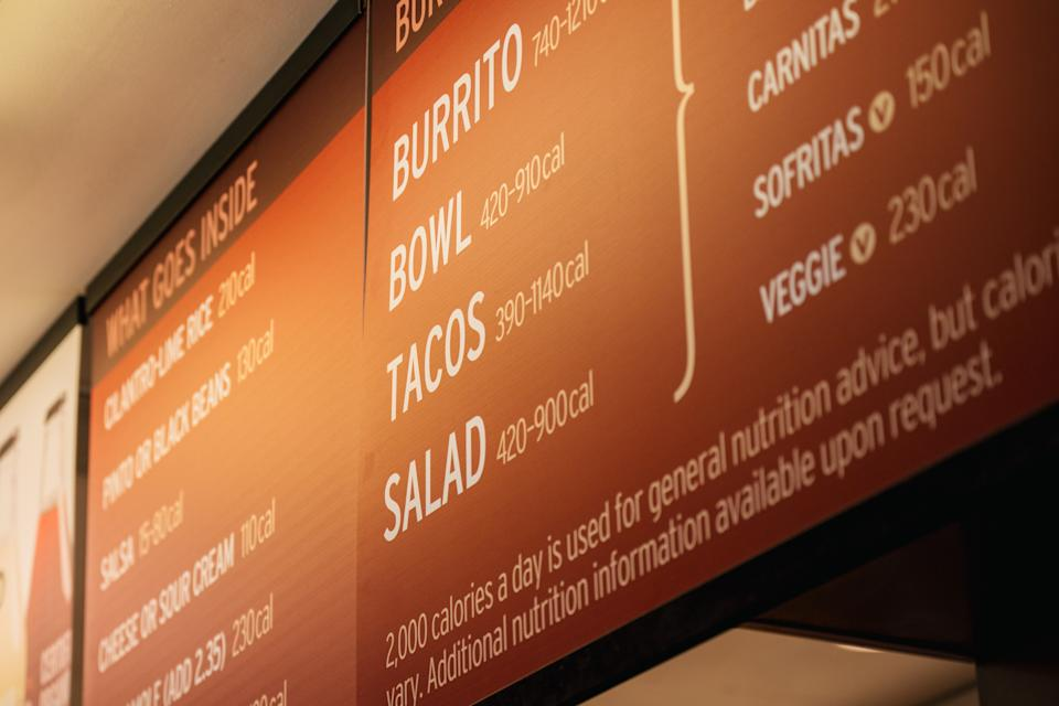 HOUSTON, TEXAS - JUNE 09: A Chipotle Mexican Grill menu is shown on June 09, 2021 in Houston, Texas. Menu prices at Chipotle Mexican Grill have risen by roughly four percent to cover the costs of raising its minimum wage to $15 an hour for employees. The restaurant industry has been boosting wages in the hopes of attracting workers during a labor crunch. (Photo by Brandon Bell/Getty Images)