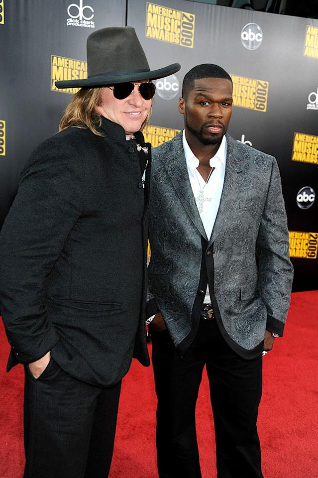 "Val Kilmer and 50 Cent  Grade: B-  The movie star wore a wool coat with black slacks and a Pilgrim-like hat, while his rapping pal paired a paisley jacket with a scarily arched eyebrow and diamond cross. Jeff Kravitz/AMA2009/<a href=""http://filmmagic.com/"" target=""new"">FilmMagic.com</a> - November 22, 2009"